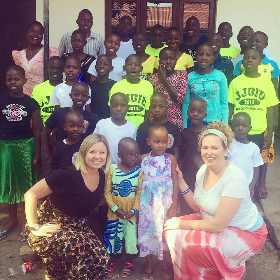 Mimi and April posing for a photo with Children from the Orphanage during a recent visit.